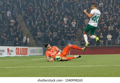 STOCKHOLM, SWEDEN - MAR 10, 2019: Keeper Per Bratveit make a goalkeeper rescue in the Swedish soccer cup quarter finals between Djurgarden vs Hammarby. March 10 2019,Stockholm,Sweden