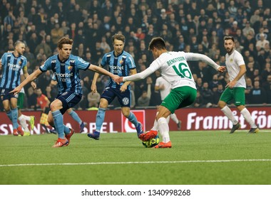 STOCKHOLM, SWEDEN - MAR 10, 2019: Duel between Bengtsson and competitors at the Swedish soccer cup quarter finals between Djurgarden vs Hammarby. March 10 2019,Stockholm,Sweden