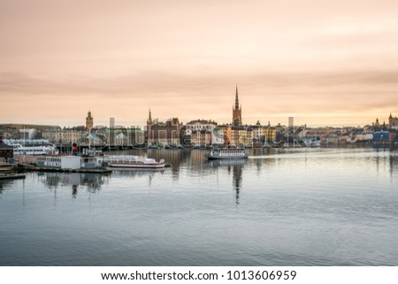 STOCKHOLM, SWEDEN - MARCH 15, 2016: Panoramic view of the Old Town and Riddarholmen by the water in Stockholm March 15, 2016. Local ferrys and sightseeing boats in the foreground.