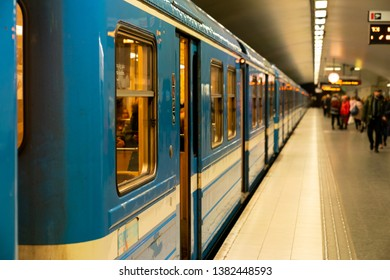 """STOCKHOLM, SWEDEN; March 19 2019: Business day in the underground metro tunnelbana station of Stockholm. """"östermalmstorg"""" Red line."""