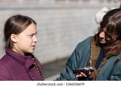 STOCKHOLM, SWEDEN - MARCH 22, 2019:  16-year-old Swedish climate activist Greta Thunberg demonstrating in Stockholm on Fridays. Interviewed by reporter.