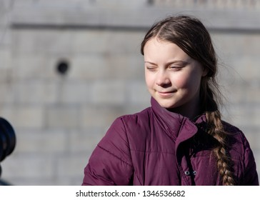STOCKHOLM, SWEDEN - MARCH 22, 2019:  16-year-old Swedish climate activist Greta Thunberg demonstrating in Stockholm on Fridays. Posing for photo.