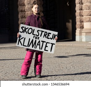 "STOCKHOLM, SWEDEN - MARCH 22, 2019:  16-year-old Swedish climate activist Greta Thunberg demonstrating in Stockholm on Fridays. Holding a sign that says ""School strike for Climate""."