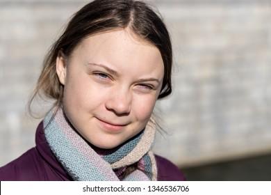 STOCKHOLM, SWEDEN - MARCH 22, 2019:  16-year-old Swedish climate activist Greta Thunberg demonstrating in Stockholm on Fridays.