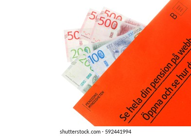 Stockholm, Sweden - March 3, 2017:The orange envelope from the Swedish Pensions Agency (Pensionsmyndigheten) with teh annual statement on top of Swedish banknotes.