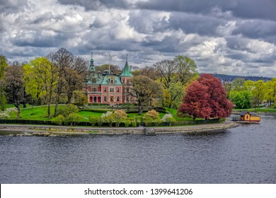 STOCKHOLM, SWEDEN - May 03, 2019: Castle-like villa Tacka Udden was built in 1869–1870 after drawings by the brothers Axel Kumlien and Hjalmar Kumlien on the island of Djurgarden.