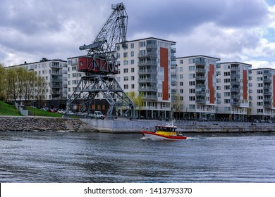 STOCKHOLM, SWEDEN - May 03, 2019: The SAR (Search and Rescue) speed boat Rebecka af Odd Fellow passes underway of the canal Hammarby in Stockholm. Operated by The Swedish Sea Rescue Society SSRS.