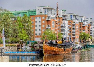 STOCKHOLM, SWEDEN - May 03, 2019: Floating thai restaurant THAIBOAT ih shape of vintage viking ship with own artificial mini beach on a raft on Hammarby canal. Sodermalm, Stockholm, Sweden.