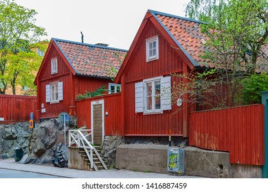 STOCKHOLM, SWEDEN - May 03, 2019: A typical swedish small wooden residential house painted in traditional falun red on the skippers alley Skeppargrand in a historic residential area on Asoberget.