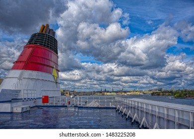 STOCKHOLM, SWEDEN - May 03, 2019: Chimney of the Viking line passenger ferry in front of the historic Gamla Stan (Old Town) district in Stockholm.