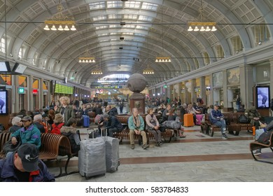 STOCKHOLM, SWEDEN - MAY 05, 2016: Lots of people waiting in the central train station hall sitting on benches. May 05, 2016, Stockholm Sweden