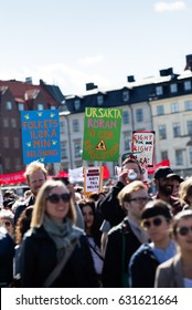STOCKHOLM, SWEDEN - MAY 1, 2017: First May Labor day demonstration in Stockholm. people marching with banners about better employee conditions, 6-hour working day.