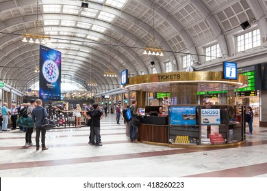Stockholm, Sweden - May 10, 2016 : Tourist information center at the Stockholm Central Station. Tourists are asking information at the information desk.