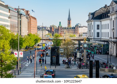 STOCKHOLM, SWEDEN - MAY 11, 2018: Outdoor horizontal cityscape view of the entrance to the central train station with people in the city of Stockholm May 11, 2018.