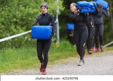 STOCKHOLM, SWEDEN - MAY 14, 2016 Tough Viking obstacle course around Stockholm Stadion with the carry water obstacle.
