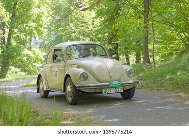 STOCKHOLM, SWEDEN - MAY 20, 2018: White color Volkswagen classic car from 1971 in the public race Gardesloppet in the forests at Djurgarden, Stockholm, Sweden. May 20, 2018