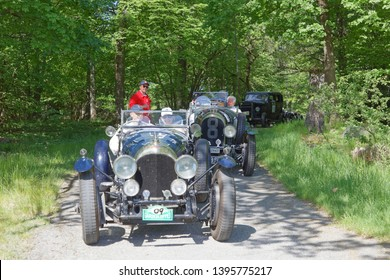 STOCKHOLM, SWEDEN - MAY 20, 2018: Black color Bently 3-Litre classic car from 1923 driving on a country road in the public race Gardesloppet in the forests at Djurgarden, Stockholm, Sweden.May 20, 201