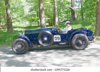 STOCKHOLM, SWEDEN - MAY 20, 2018: Blue color Bently 3-Litre classic car from 1923 driving on a country road in the public race Gardesloppet in the forests at Djurgarden, Stockholm, Sweden. May 20,2018