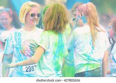 STOCKHOLM, SWEDEN - MAY 22, 2016: Female runners in the haze at the last blue station at Color Run Tropicolor world tour in Stockholm