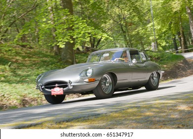 STOCKHOLM, SWEDEN - MAY 22, 2017: Silver Jaguar E-type Serie1 Coupe classic car from 1963 driving on a country road in the public race Gardesloppet at Djurgarden, Stockholm, Sweden. May 22, 2017