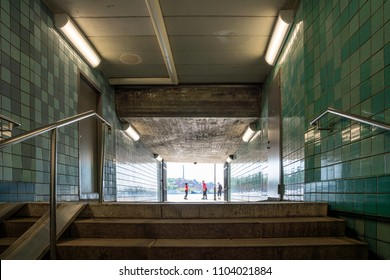 STOCKHOLM, SWEDEN - MAY 26, 2018: Low angle view of stairs in a subway underpass in Stockholm Sweden May 26, 2018. Incidental people in the background.