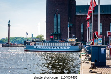 STOCKHOLM, SWEDEN - MAY 26, 2018: Profile view of Stromma Kanlalbolag´s  city steam ship ferry with passengers berthing the quay in Stockholm Sweden May 26, 2018.