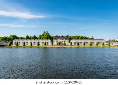 STOCKHOLM, SWEDEN - MAY 26, 2018: Beautiful summer front view of the famous military academy Karlberg castle by the water in Stockholm Sweden May 26, 2018.
