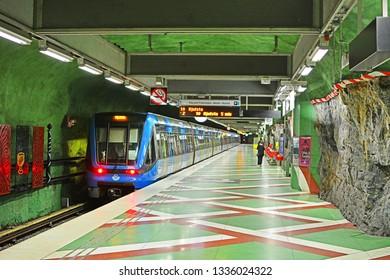 STOCKHOLM, SWEDEN - MAY 31, 2018 - A modern SL C20 Bombardier metro train, operated by Storstockholms Lokaltrafik (SL), at Kungstradgarden underground station, carved in rock