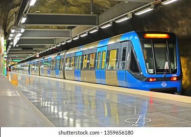 STOCKHOLM, SWEDEN - MAY 31, 2018 - A modern SL C20 Bombardier metro train, operated by Storstockholms Lokaltrafik (SL), at Vastra skogen underground station, carved in rock