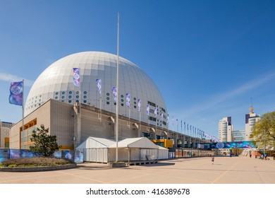 Stockholm, Sweden - May 6 : External view of the Stockholm Globe Arena with the official Eurovision flags flapping in winds. The Grand finale will be held in the Globe on May 14 at here.
