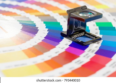 STOCKHOLM - SWEDEN, NOV 08, 2017: Magnifier or Printers Loupe on colorful color palette in Stockholm, Sweden, November 08, 2017