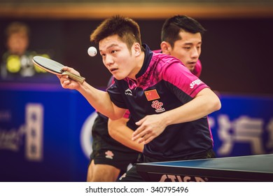 STOCKHOLM, SWEDEN - NOV 15, 2015: Final match in double between Zhendong, Jike (CHI) and Bo, Xin (CHI) at the table tennis tournament SOC at the arena Eriksdalshallen.