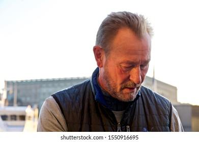 STOCKHOLM, SWEDEN - NOVEMBER 5, 2019: Ice hockey coach James Stephen Smith writing autographs outside the Grand Hotel Stockholm.