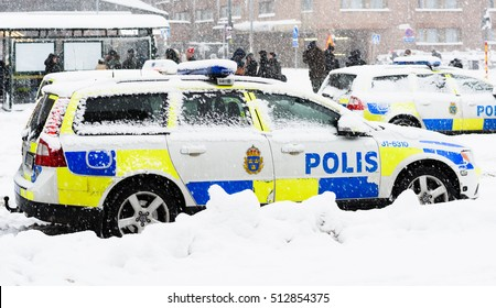 Stockholm, Sweden - November 9, 2016: Swedish Police cars parked a winter day when it is snowing outside the main train station, Stockholms centralstation