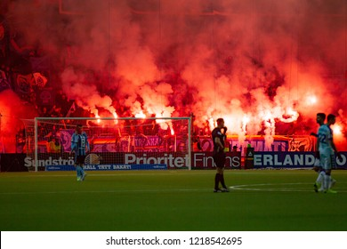 STOCKHOLM, SWEDEN - OCT 31, 2018: Djurgardens IF (DIF) vs IFK Goteborg in a football game at Tele2 Arena in Stockholm. Flares burning.