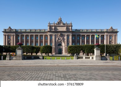 Stockholm, Sweden - Oct 6, 2015 : Exterior view, without parked cars and Swedish Flag shown, of Swedish Parliament House from the east at day time.