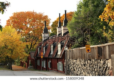 STOCKHOLM, SWEDEN - OCTOBER 11: Old red cottages in central Stockholm in autumn colors shown on October 11, 2013 in Stockholm.