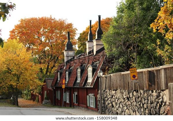 STOCKHOLM, SWEDEN - OCTOBER 11: Old red cottages in central Stockholm in autumn colors shown on October 11, 2013 in Stockholm.