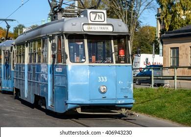 STOCKHOLM, SWEDEN - OCTOBER 12, 2015: LITHUANIA - FEBRUARY 21, 2016:  Stockholm public transport. Old blue tram, autumn backgrund.