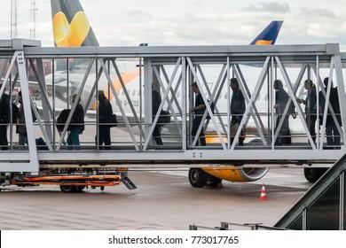 Stockholm, Sweden- October 13th 2017:Passengers boarding an aircraft along an airbridge