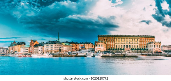 Stockholm, Sweden. Scenic View Of Embankment In Old Part Of Stockholm At Summer Evening, Sweden. Panorama. Famous Cityscape At Sunset Time. Popular Tourist Place.