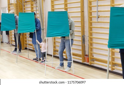 STOCKHOLM, SWEDEN - SEP 09, 2018: People voting in the polling-booth in the general elections in Sweden 2018, September 09, 2018 in Stockholm, Sweden