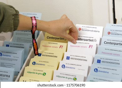 STOCKHOLM, SWEDEN - SEP 09, 2018: Selectiing ballot papers before voting in the polling-booth in the general elections in Sweden 2018, September 09, 2018 in Stockholm, Sweden