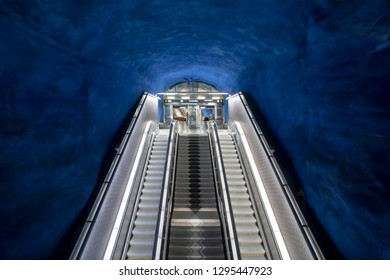 STOCKHOLM, SWEDEN - SEP 14: Empty moving staircase in tunnel of underground station with colorful design on September 14, 2018. Stockholm metro system has 100 stations with arts, mosaics