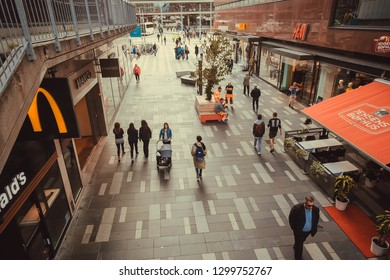 STOCKHOLM, SWEDEN - SEP 14: Street with people walking and shopping at urban designed stores of swedish capital on September 14, 2018. Sweden with 10,5 million peope ranks high in life expectancy