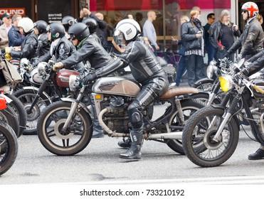STOCKHOLM, SWEDEN - SEPT 02, 2017: Sideview of mc drivers in leather clothes on vintage motorcycles  at the Mods vs Rockers event at the Saint Eriks bridge, Stockholm, Sweden, September 02, 2017