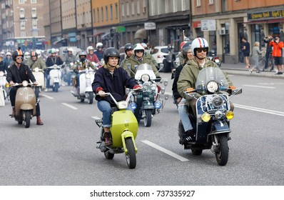 STOCKHOLM, SWEDEN - SEPT 02, 2017: Mods driving old fashioned vespa scooter with many lamps at the Mods vs Rockers event at the Saint Eriks bridge, Stockholm, Sweden, September 02, 2017