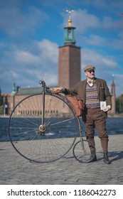 STOCKHOLM, SWEDEN, SEPT 22, 2018: Bike in tweed bicycle tour with vintage bikes and clothes. Before start with backdrop of city hall.