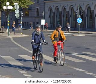 STOCKHOLM, SWEDEN - SEPT 25, 2018: Cyclists on street of Stockholm