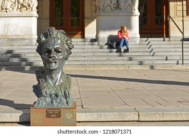 STOCKHOLM, SWEDEN - SEPT 25, 2018: August Strindberg Sculpture (1909) by Knut Jern in front of Royal Dramatic Theatre (1908). He was Swedish playwright, novelist, poet, essayist and painter
